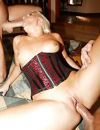 Two dicks in corset girl