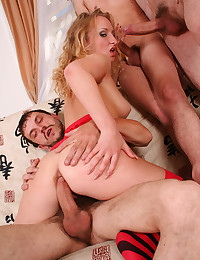 Gorgeous Blonde Surrounded By Cocks