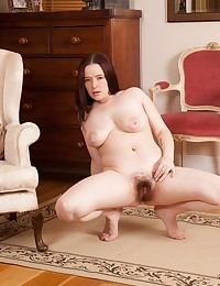 Ely Louise spreads her creamy thighs and shows off her thick pussy hair and round pale ass!