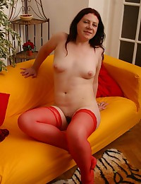 Red stockings on curvy brunette