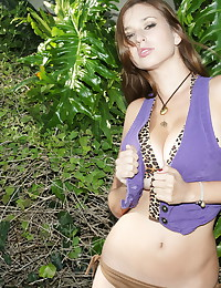Legs are open and pussy is exposed in solo girl outdoor gallery