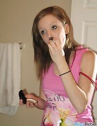 Riley Rebel - Lovely teenage temptress putting makeup on in front of the camera