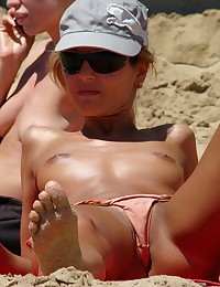 Barefaced bikini panties on a beach