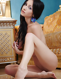 Stunning brunette touches herself on the floor.