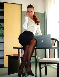Secretary in satin blouse bon...
