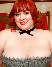 BBW redhead in a corset