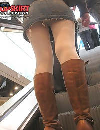 Babe in white pantyhose peeked. Escalator upskirt