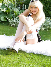 Lolly Hardcore - Teen girl in the fetish outfit of a naughty old spice poses alfresco