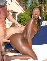 Sexy outdoors with slick black chick