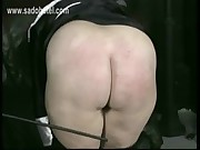 Horny nun slave is spanked on her well formed ass and hands by older priest