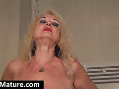 Big Meloned Blonde Granny Strip Erotically