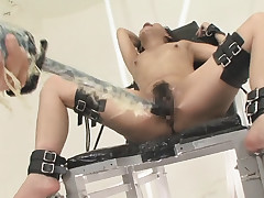 Asian patient restrained and fucked with toys