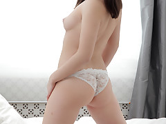 Dark haired hottie with a never-ending craving for orgasms strips off her bra and panties to slide a thick dildo in and out of her moist pussy