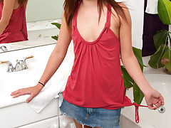 Vibrant redhead with blue eyes Maryjane Johnson offers a no-panty flash from under her miniskirt and then gets busy on a sybian