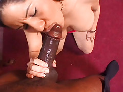 Babe gets down on her knees and sucks that big black cock!