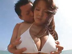 Busty Japanese bikini babe nailed on the beach