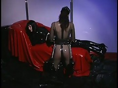 Anastasia Pierce Enjoys Rubber Slave