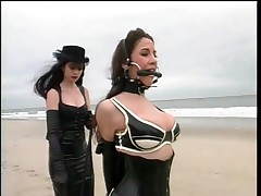 Girl Is Tied Up By Her Dominatrix On The Beach