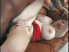 Big tit MILF takes a black cock up her ass