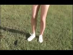 Girl in Bikini Playing Tennis