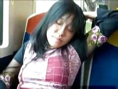 Asian girl fingers herself on public train