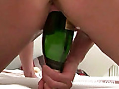 Champagne bottles stretching my ruined vagina