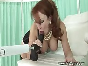Older lady sucks a fucking machine dildo