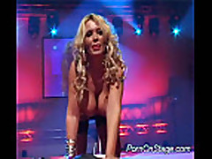 Huge tits blonde is dildoing her pussy on stage hard