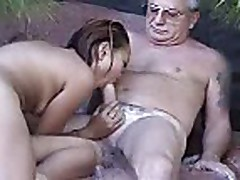 Grandpa getting head by hot asian poolside